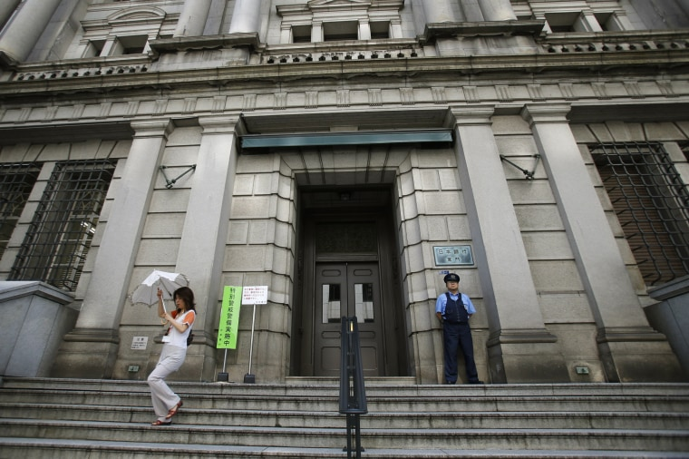 A woman leaves the Bank of Japan's headquarters in Tokyo in 2013.