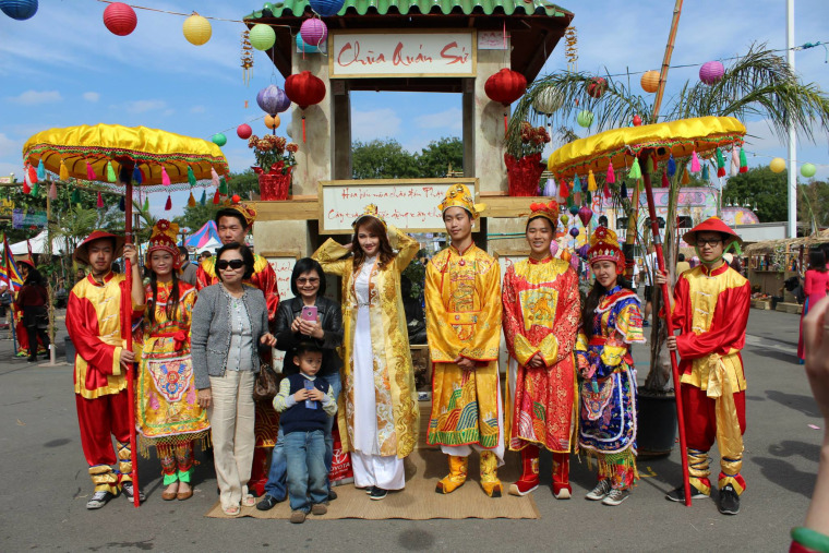 The UVSA Tet Festival royal court pose in front of a recreation of a Vietnamese temple.
