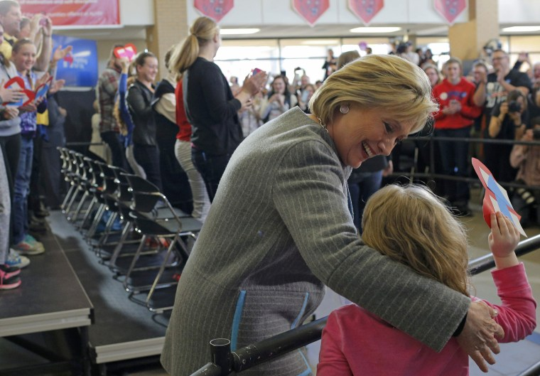 Image: U.S. Democratic presidential candidate Hillary Clinton is greeted by a young girl in Council Bluffs