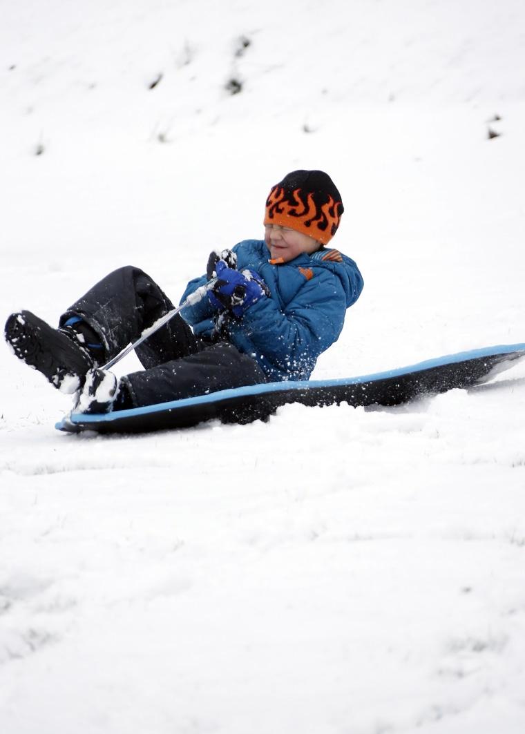 kid sledding