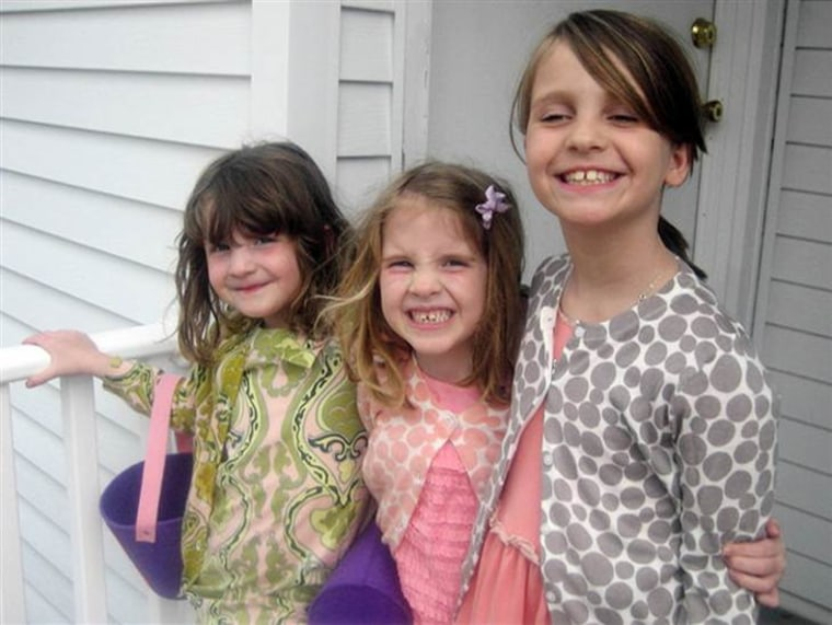 Madonna Badger claims she has had visions of her three young daughters lost in the fire, twins Sarah and Grace, 7 (left), and Lily, 9. A fund has been set up in their name to support arts education in public schools.