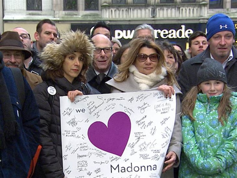 A group of more than 100 people showed their support for Madonna Badger by gathering on the plaza at Rockefeller Center on Thursday.
