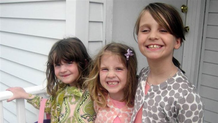 Madonna Badger's three young daughters, twins Sarah and Grace, 7 (left), and Lily, 9.
