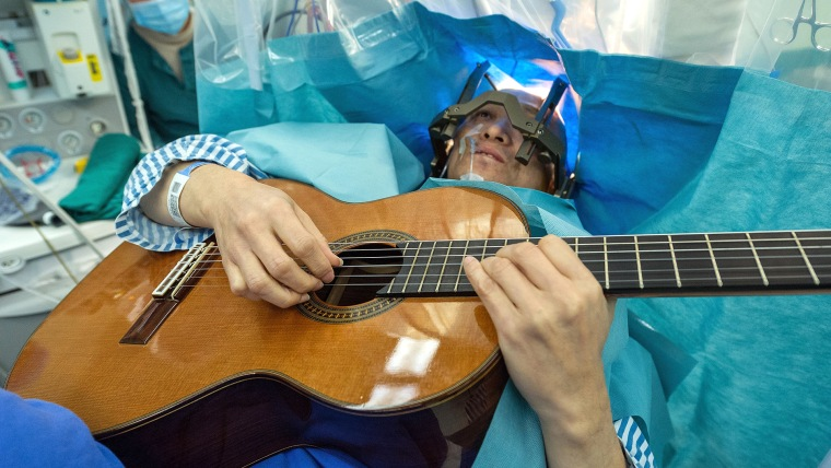 Man plays guitar while having brain surgery
