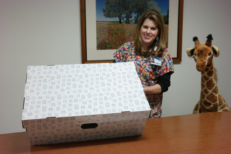 IMAGE: Nurse Kelli Brimagner with a baby box