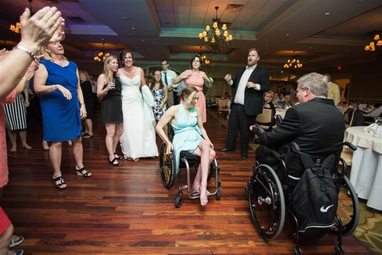Paul Martin, in wheelchair, dances at his daughter's wedding as bride Brittany Dejean (in background) looks on.
