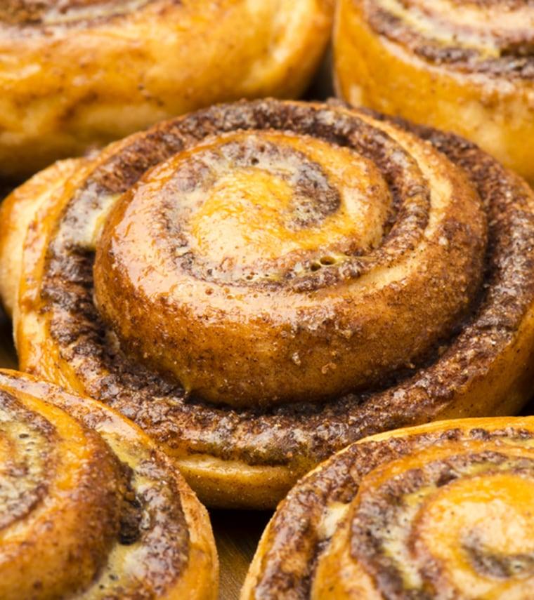 Homemade cinnamon buns as background.