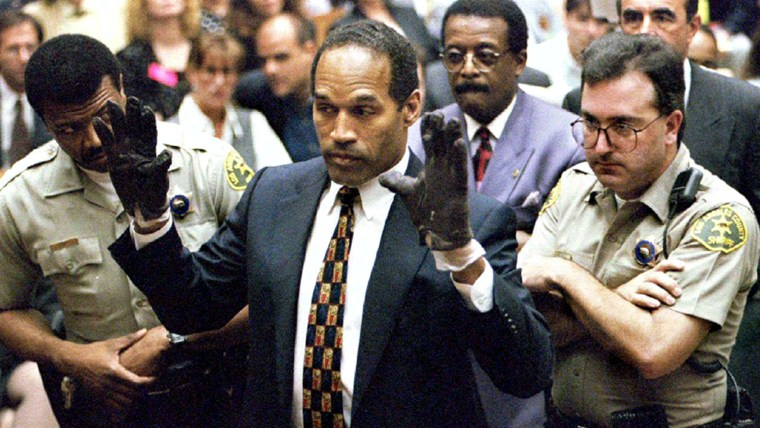 O.J. Simpson holds up his hands to the jury wearing the infamous gloves found at the crime scene and his home during his murder trial.