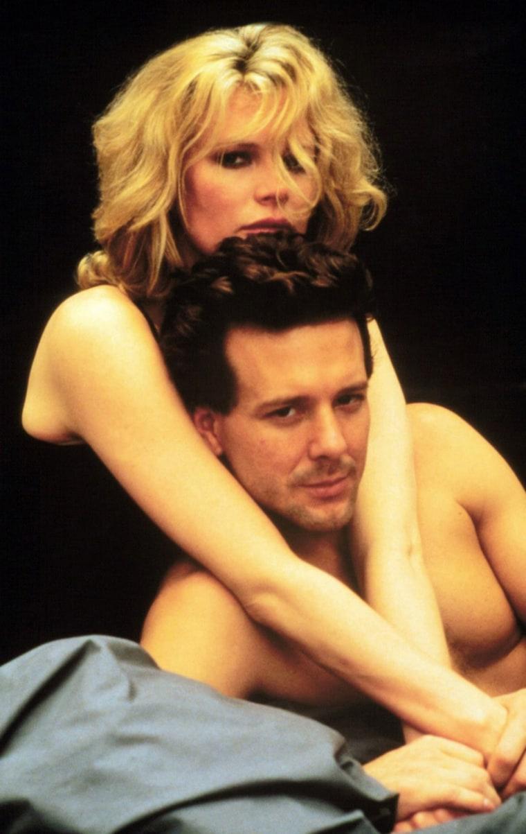 "Kim Basinger and Mickey Rourke in ""9 1/2 Weeks"""