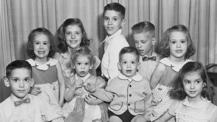 A photo of the nine Volk children, taken in 1963 when the youngest set of twins, Jim and Sandra, were three.