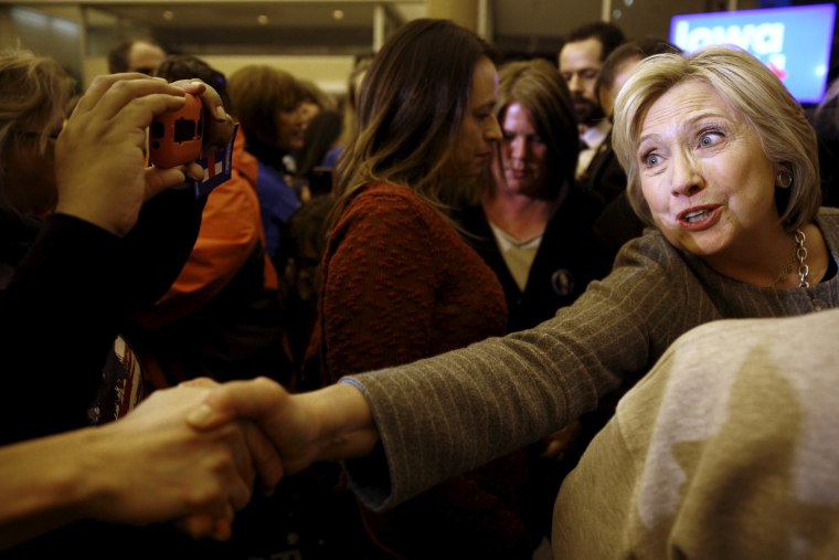 Image: Hillary Clinton shakes hands with supporters