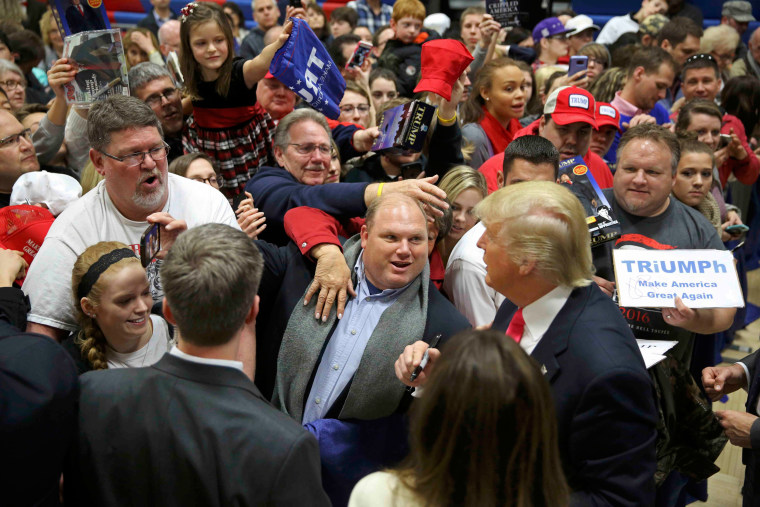 Image: Donald Trump is mobbed by supporters