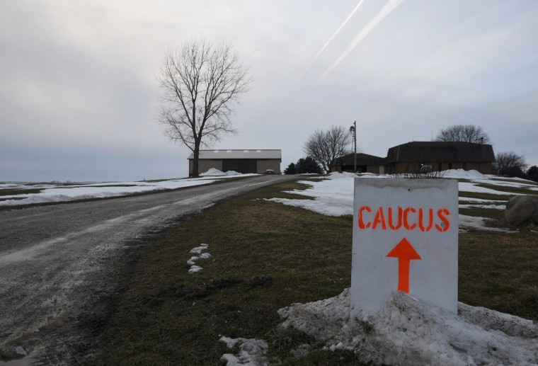 Image: A sign directs Democratic caucus goers to the home of Gary and Mary Weaver in Rippley
