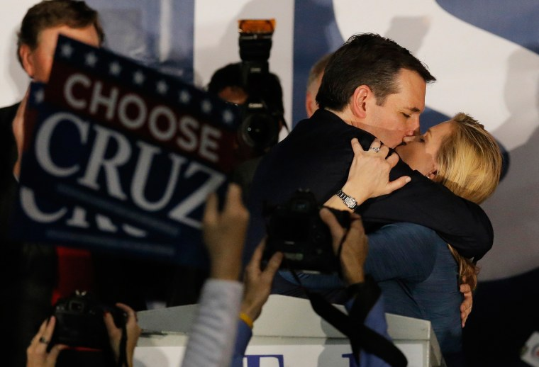 Image: U.S. Republican presidential candidate Ted Cruz kisses his wife Heidi Cruz after winning at his Iowa caucus night rally in Des Moines