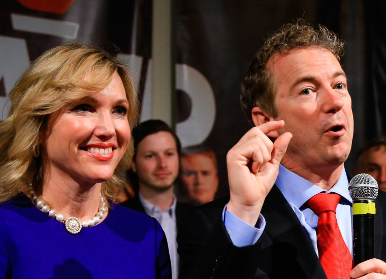 Image:Republican presidential candidate, Sen. Rand Paul, R-Ky, gestures as he speaks to supporters with his wife Kelley
