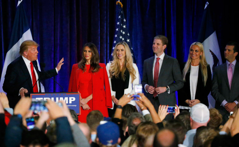 Image: Republican Presidential Candidate Donald Trump speaks with his family onstage at caucus night rally in Des Moines, Iowa