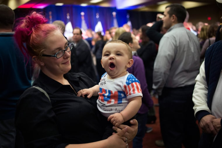 Image: A mother and her baby arrive to support U.S. Republican presidential candidate Donald Trump