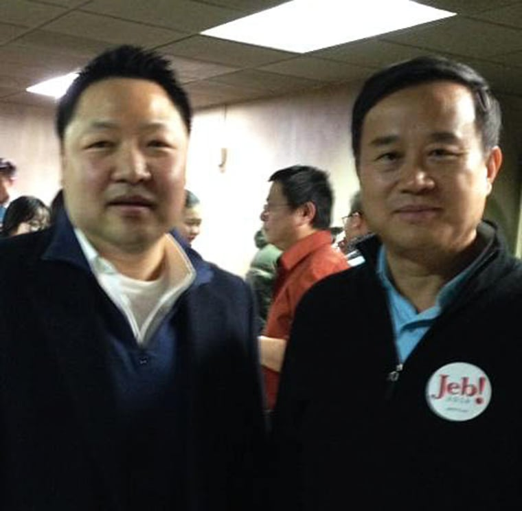 Ben Jung with a Jeb Bush supporter at the Asian-American Presidential Town Hall in Iowa, Friday, Jan. 29, 2016.