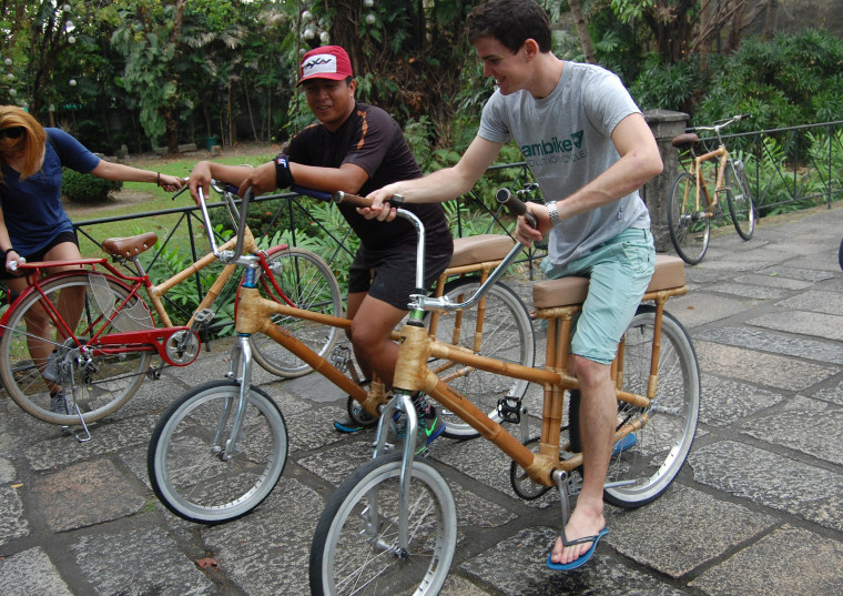 Rey Ballesca (left), Bambike's tourism manager, guides a group during a bicycle tour of the Intramuros section of Manila, Philippines, on Jan. 19.