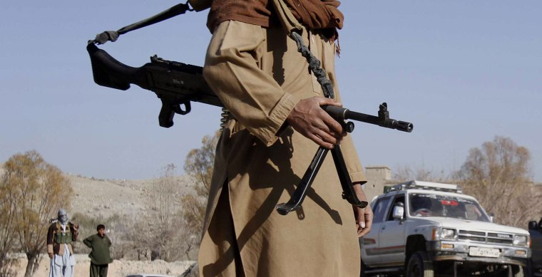 A Taliban fighter mans a checkpoint in Nangarhar province, Afghanistan, in 2010.