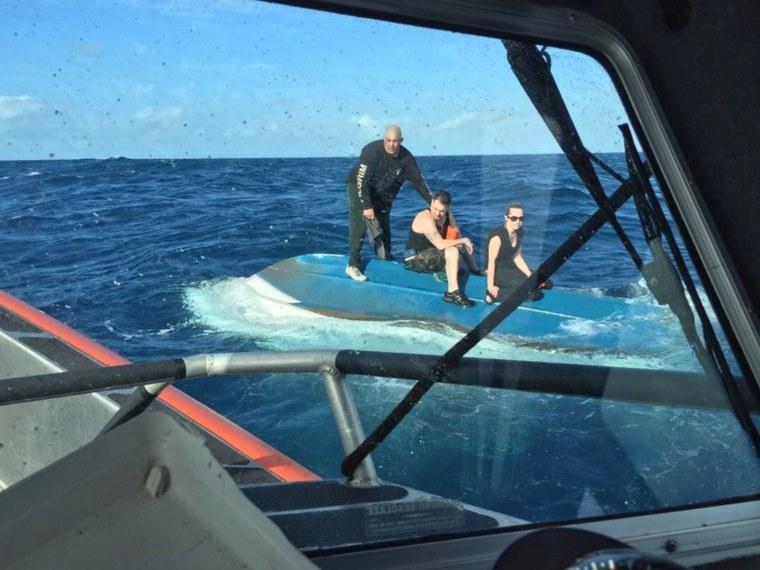 Image: USCG crews rescue 3 people from capsized vessel IVO Islamorada