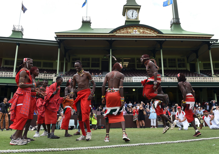 Image: Maasai Warriors from Kenya perform a dance before commencing the cricket match