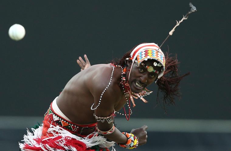 Image: A member of the Maasai Cricket Warriors bowls a ball