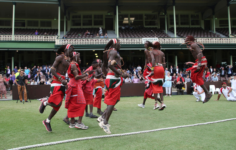 Image: Members of the Maasai Cricket Warriors do a traditional dance