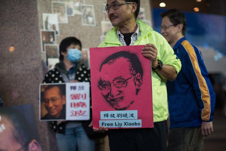 Image: Activists mark jailed nobel laureate Liu Xiaobo birthday