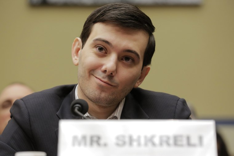 """Image: Martin Shkreli, former CEO of Turing Pharmaceuticals LLC, prepares to testify before a House Oversight and Government Reform hearing on \""""Developments in the Prescription Drug Market Oversight\"""" on Capitol Hill in Washington"""