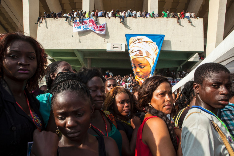 Image: People gather to take part in the funeral of Congolese Christian Gospel singer Marie Misamu