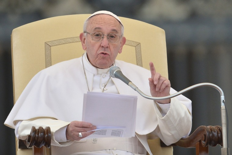 Image: Pope Francis addresses the crowd during his weekly general audience at St Peter's square