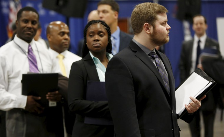 "Image: Job applicants await their turn at the Lockheed Martin booth at ""Hiring Our Heroes"" military job fair in Washington"