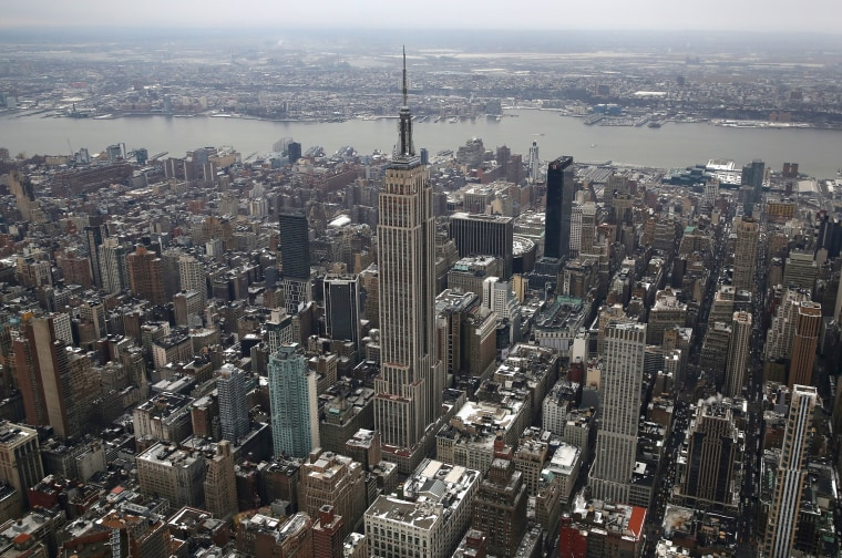 Image: The Empire State Building rises over Midtown Manhattan