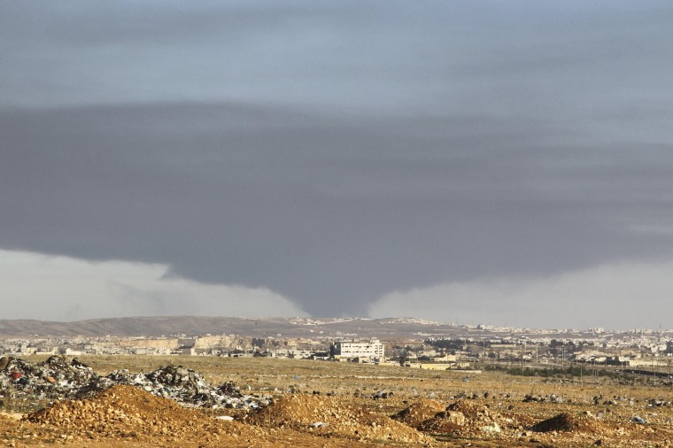 Image: Smoke rises over the industrial city in Aleppo, Syria