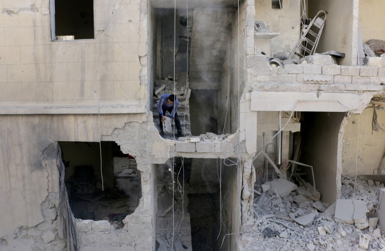 Image: Russian air crafts hit opposition controlled residential areas in Aleppo