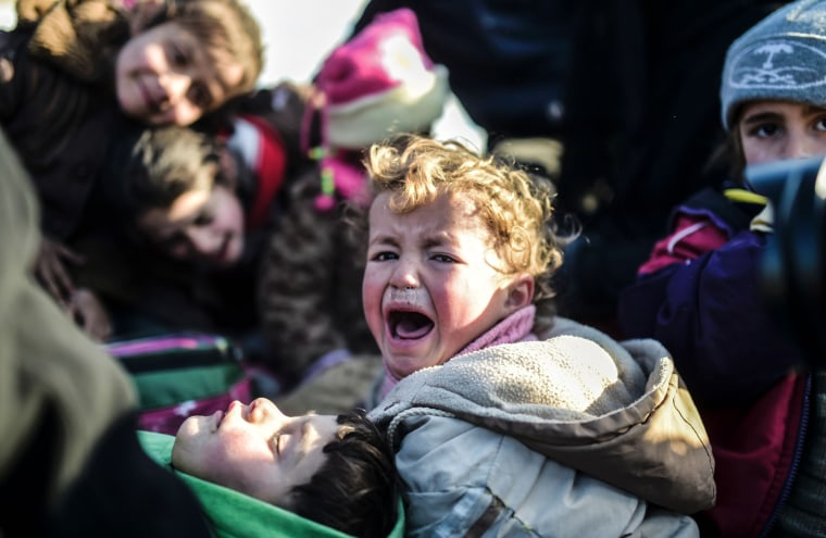 Image: A Syrian child cries as Syrians fleeing the northern embattled city of Aleppo