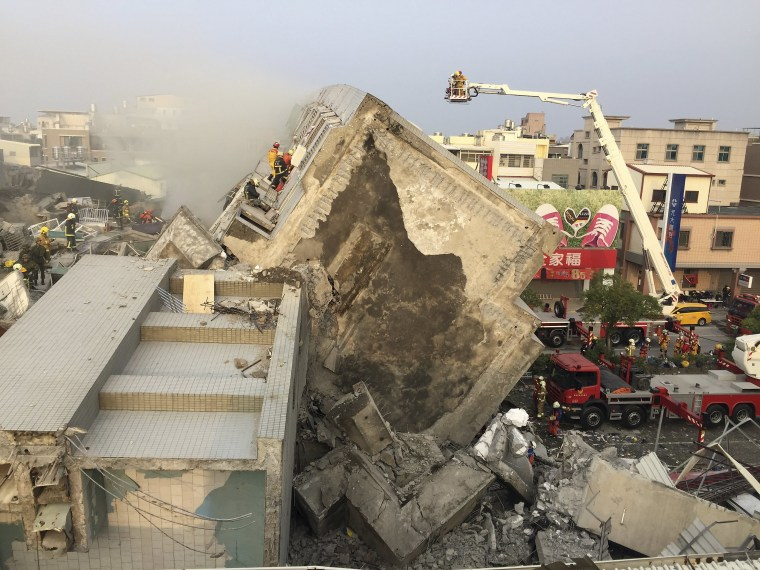 Image: Rescue personnel work on damaged buildings after an earthquake in Tainan