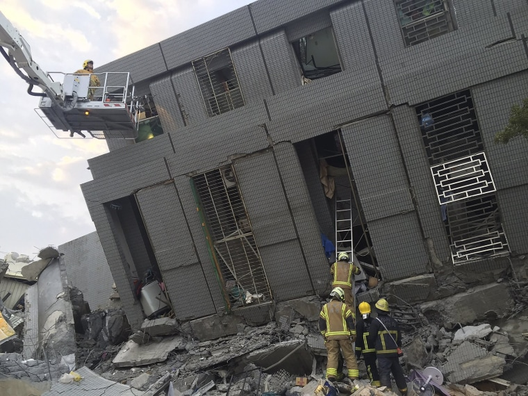 Image: Rescue personnel work at a damaged building after an earthquake in Tainan,