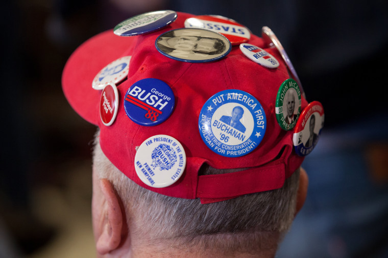 Image: A supporter attends a meeting with presidential candidate Jeb Bush