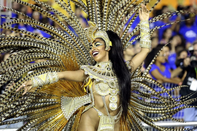 Image: A member of the samba school of the special group Aguia de Ouro performs during a parade