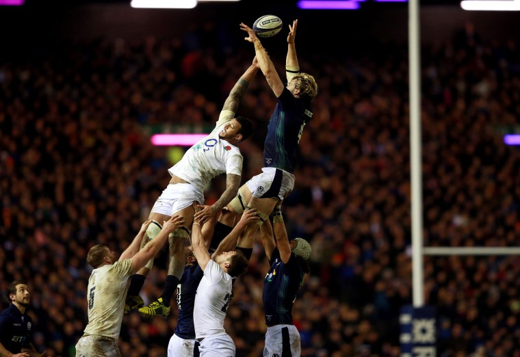 Image: England's Courtney Lawes , top left, and Scotland's Richie Gray, compete for a line out ball