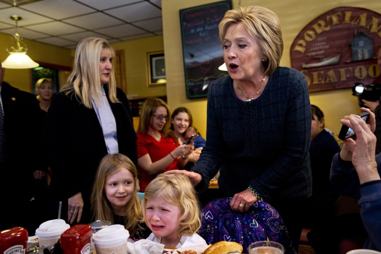Image: Ella Hamel, 4, of Concord, N.H., cries as she and her sister Ava Hamel, 7, are greeted by Hillary Clinton