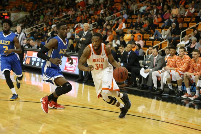 Mercer University guard Jibri Bryan, right, is seen in this photo provided by the university. Bryan was fatally shot outside a Macon, Georgia, convenience store and two people have been arrested in his death, authorities said.