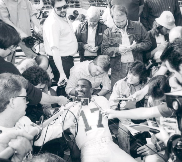 11-1988; Special to the Denver post -- Redskins quarterback Doug Williams entertains a horde of pres