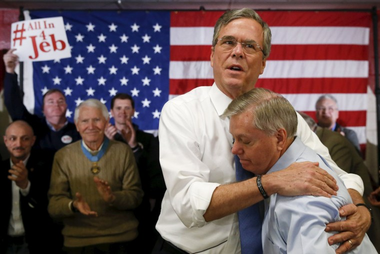 Image: Republican U.S. presidential candidate Jeb Bush embraces Senator Lindsey Graham after Graham introduced him at a town hall in Salem, New Hampshire