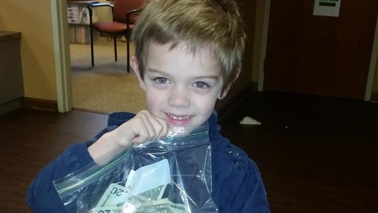 Boy makes donation to preschool teacher