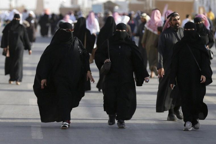 Image: Saudi women arrive to attend Janadriyah Culture Festival on the outskirts of Riyadh