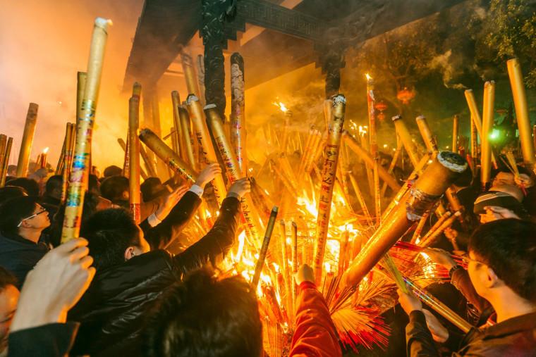 Image: People burn incense