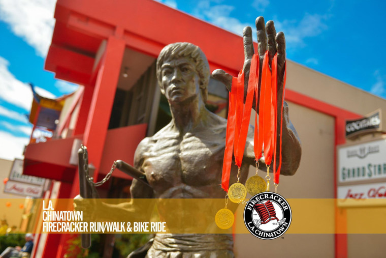 Medals hang on a statue of Bruce Lee at the 2015 Los Angeles Firecracker Run.